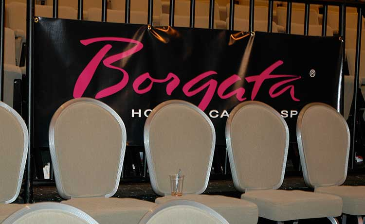 a banner that is partially obstructed by chairs that reads 'Borgata Hotel Casino & Spa'