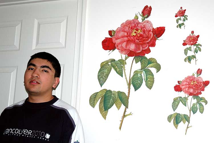 webmaster/marketer Jonathan shown with several sizes of Pierre-Joseph Redouté's 'Rose of Orleans' DEEcals