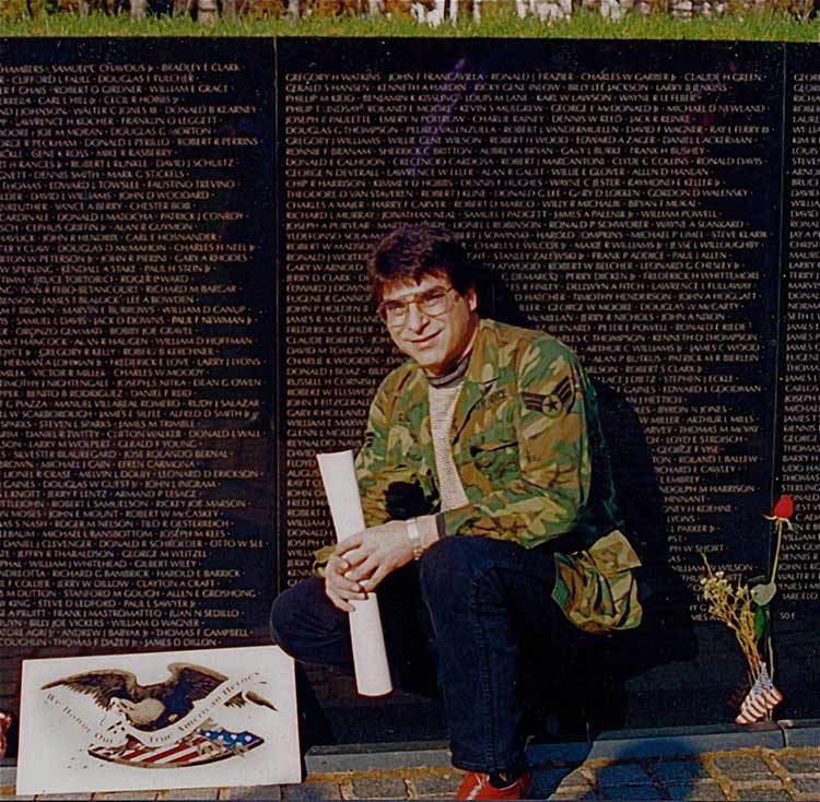 owner/founder Norman Dee pictured with some signage at the Vietnam Memorial Wall