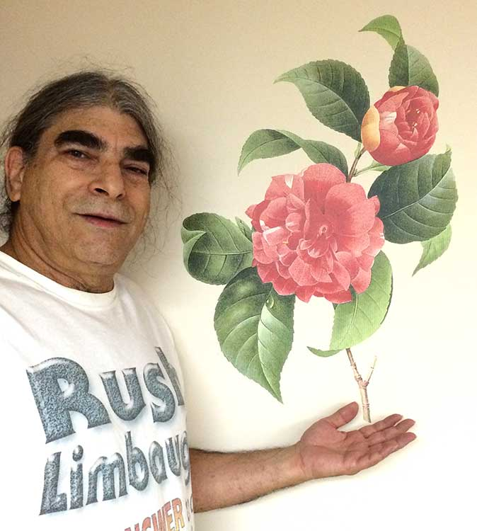 owner/founder Norman Dee posing with our Rose of Orleans DEEcal, art by Pierre-Joseph Redouté