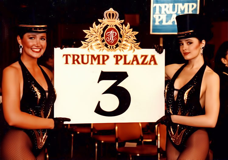 two female of employees at Trump Plaza holding a 'round card' designed by Norman Dee Associates