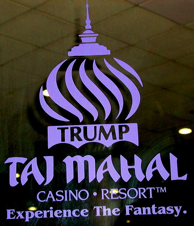 screen printing of glass with 'Trump Taj Mahal Casino Resort Experience The Fantasy.' and the Trump Taj Mahal logo